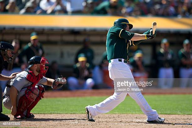 Sean Doolittle of the Oakland Athletics at bat against the Boston Red Sox during the tenth inning at Oco Coliseum on June 22 2014 in Oakland...