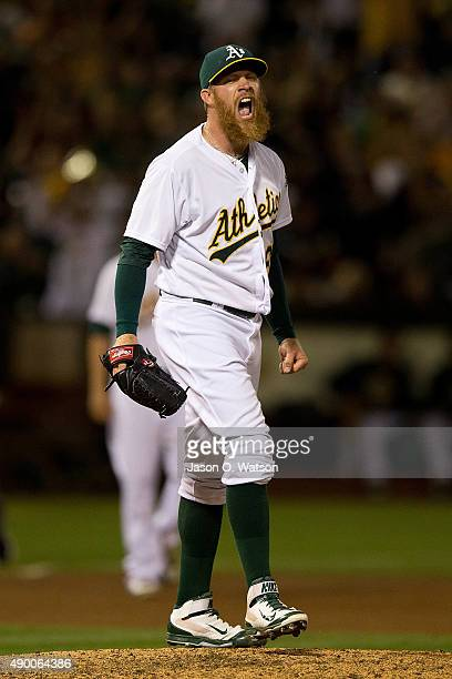 Sean Doolittle of the Oakland Athletics celebrates after the game against the San Francisco Giants at Oco Coliseum on September 25 2015 in Oakland...