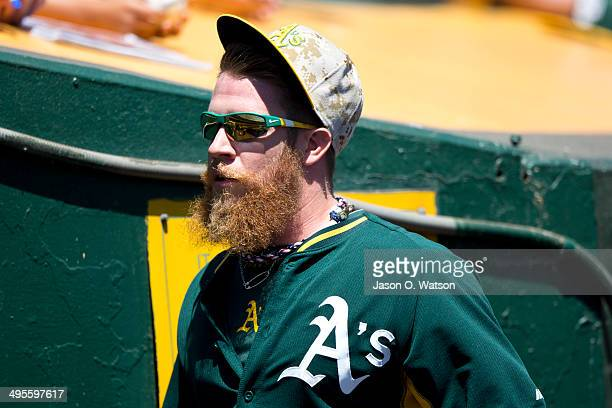 Sean Doolittle of the Oakland Athletics looks on during batting practice before the game against the Detroit Tigers at Oco Coliseum on May 26 2014 in...