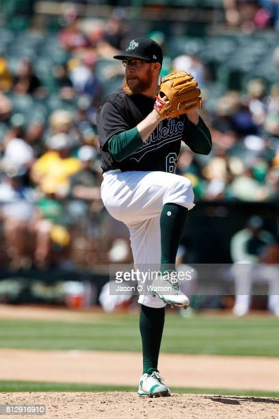 Sean Doolittle of the Oakland Athletics pitches against the Atlanta Braves during the seventh inning at the Oakland Coliseum on July 1 2017 in...