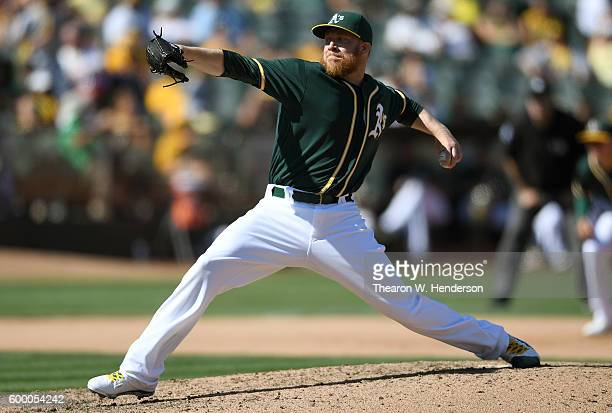 Sean Doolittle of the Oakland Athletics pitches against the Los Angeles Angels of Anaheim in the top of the seventh inning at OaklandAlameda County...