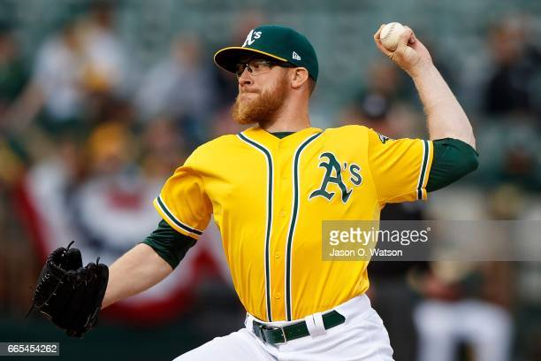 Sean Doolittle of the Oakland Athletics pitches against the Los Angeles Angels of Anaheim during the ninth inning at the Oakland Coliseum on April 6...