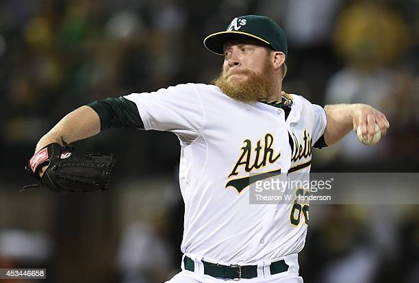Sean Doolittle of the Oakland Athletics pitches against the Minnesota Twins in the top of the ninth inning at Oco Coliseum on August 8 2014 in...