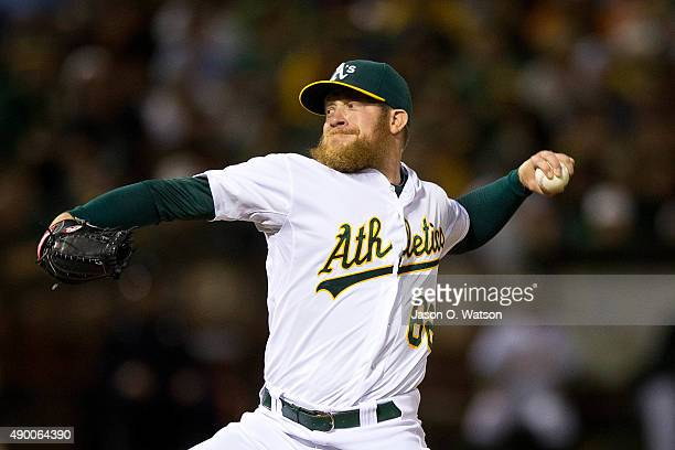 Sean Doolittle of the Oakland Athletics pitches against the San Francisco Giants during the eighth inning at Oco Coliseum on September 25 2015 in...