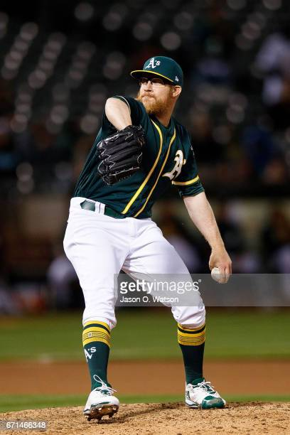Sean Doolittle of the Oakland Athletics pitches against the Texas Rangers during the seventh inning at the Oakland Coliseum on April 18 2017 in...