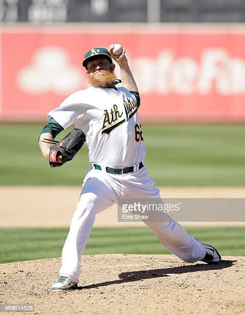 Sean Doolittle of the Oakland Athletics pitches against the Toronto Blue Jays at Oco Coliseum on July 6 2014 in Oakland California