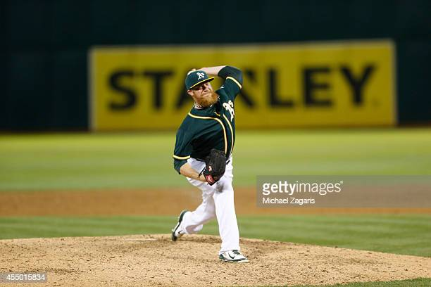 Sean Doolittle of the Oakland Athletics pitches during the game against the Los Angeles Angels of Anaheim at Oco Coliseum on August 23 2014 in...