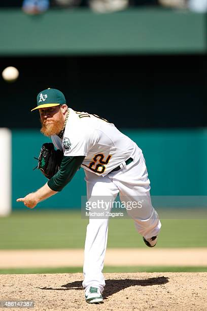 Sean Doolittle of the Oakland Athletics pitches during the game against the Seattle Mariners at Oco Coliseum on April 6 2014 in Oakland California...