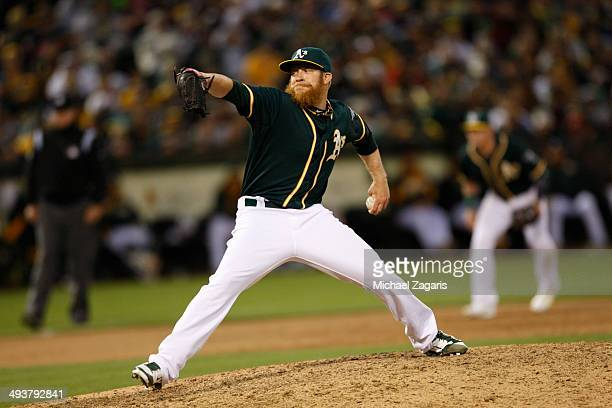Sean Doolittle of the Oakland Athletics pitches during the game against the Washington Nationals at Oco Coliseum on May 10 2014 in Oakland California...