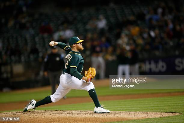 Sean Doolittle of the Oakland Athletics pitches during the game against the Cleveland Indians at the Oakland Alameda Coliseum on July 14 2017 in...