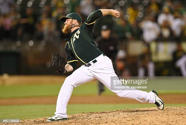Sean Doolittle of the Oakland Athletics pitches in the ninth inning against the Chicago White Sox at Oco Coliseum on May 12 2014 in Oakland California