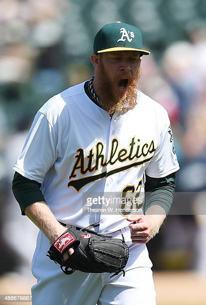 Sean Doolittle of the Oakland Athletics reacts after striking out Mike Zunino of the Seattle Mariners for the third out of the top of the ninth...