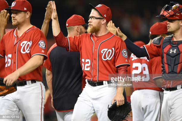Sean Doolittle of the Washington Nationals celebrates a win after game two of a doubleheader against the Colorado Rockies at Nationals Park on July...