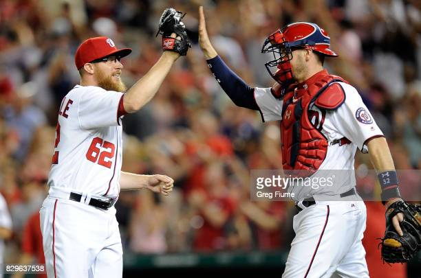 Sean Doolittle of the Washington Nationals celebrates with Matt Wieters after a 32 victory against the Miami Marlins at Nationals Park on August 10...