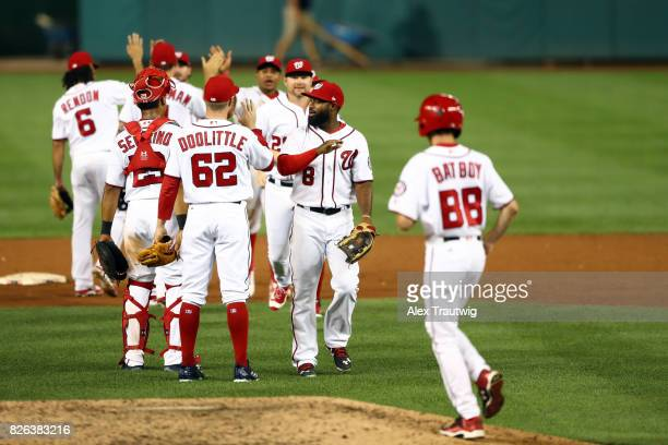 Sean Doolittle of the Washington Nationals celebrates with teammates after defeating the Milwaukee Brewers at Nationals Park on Wednesday July 26...
