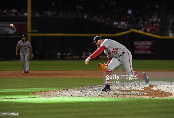 Sean Doolittle of the Washington Nationals delivers a ninth inning pitch against the Arizona Diamondbacks at Chase Field on July 23 2017 in Phoenix...