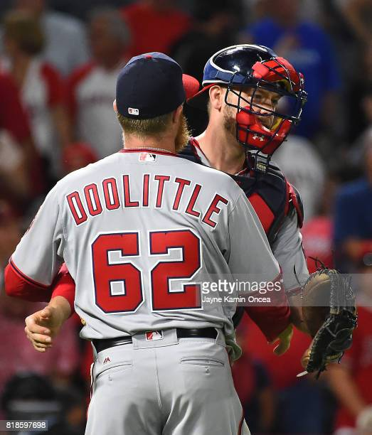 Sean Doolittle of the Washington Nationals gets a hug from Matt Wieters after a save in the ninth inning of the game against the Los Angeles Angels...
