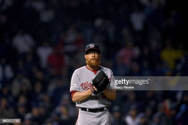 Sean Doolittle of the Washington Nationals pitches in the ninth inning during game four of the National League Division Series against the Chicago...