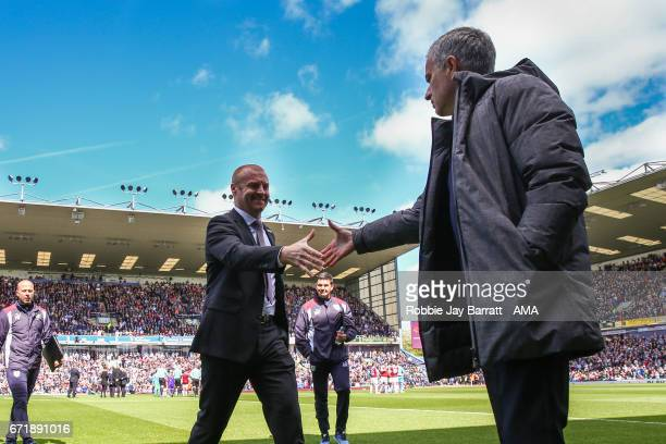 Sean Dyche manager / head coach of Burnley and Jose Mourinho manager / head coach of Manchester United shake hands during the Premier League match...