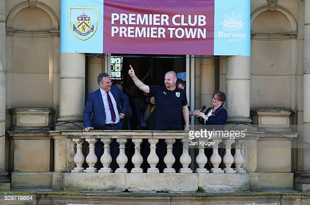 Sean Dyche manager of Burnley salutes the crowd as Burnley chairman Mike Garlick looks on as Sky Bet Champions Burnley are presented with the...