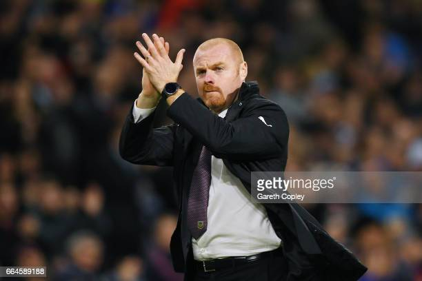 Sean Dyche Manager of Burnley shows appreciation to the fans after the Premier League match between Burnley and Stoke City at Turf Moor on April 4...