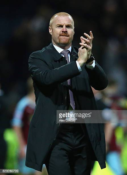 Sean Dyche the manager of Burnley applauds his support after victory over Preston North End in the Sky Bet Championship match between Preston North...