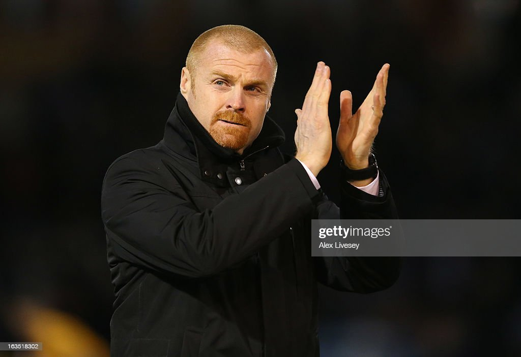 <a gi-track='captionPersonalityLinkClicked' href=/galleries/search?phrase=Sean+Dyche&family=editorial&specificpeople=886017 ng-click='$event.stopPropagation()'>Sean Dyche</a> the manager of Burnley applauds his supporters during the npower Championship match between Burnley and Hull City at Turf Moor on March 11, 2013 in Burnley, England.