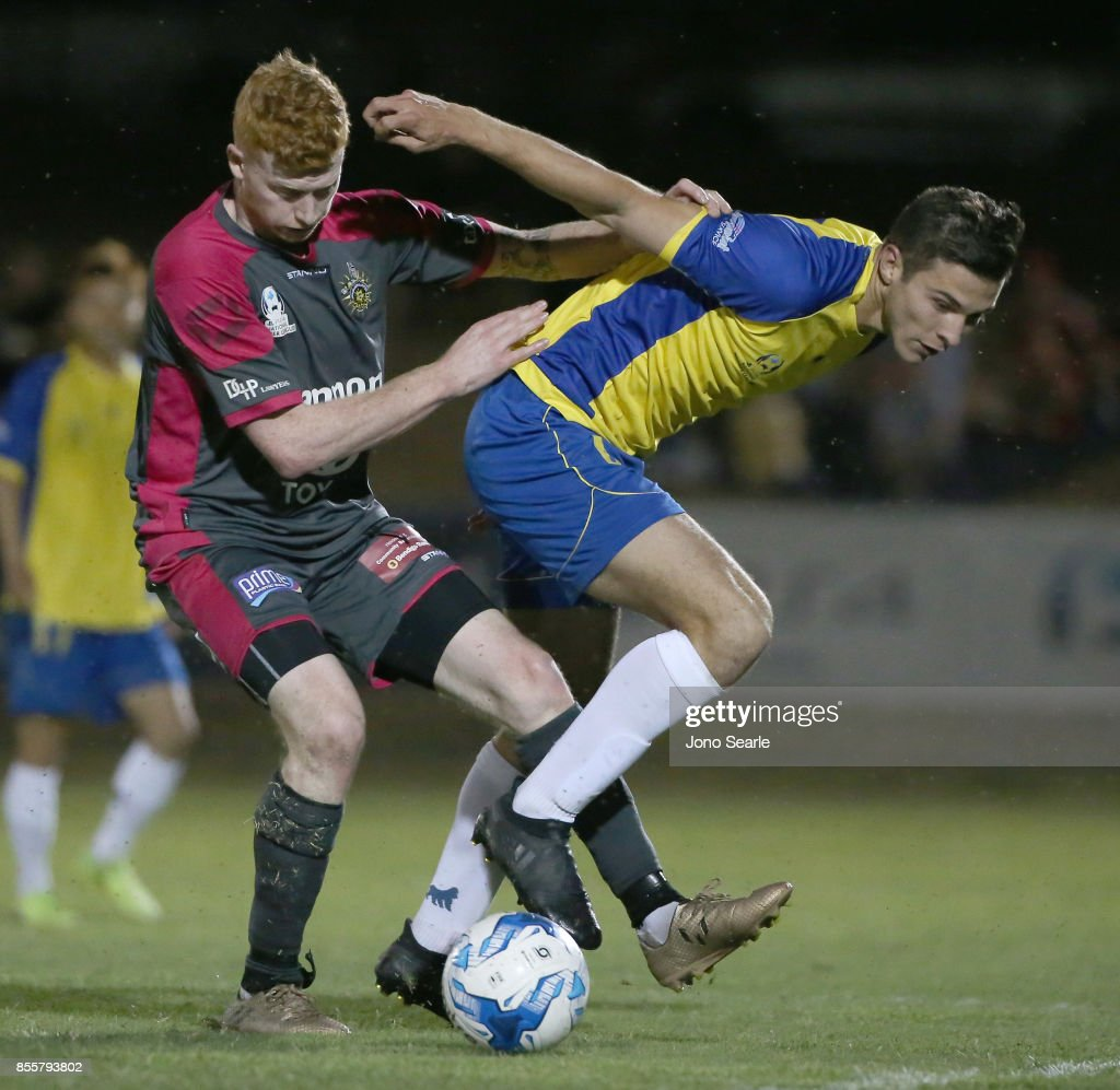 Sean Ellis of Heidelberg United FC and Ethan Docherty of the Strikers compete for the ball during the National Premier Leagues Grand Final match between the Brisbane Strikers and Heidelberg United FC at Perry Park on September 30, 2017 in Brisbane, Australia.