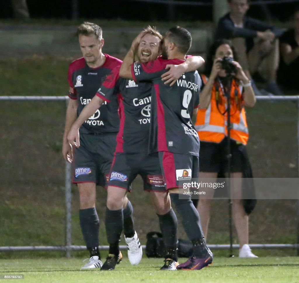 Sean Ellis of Heidelberg United FC (center) celebrates his goal with team mates during the National Premier Leagues Grand Final match between the Brisbane Strikers and Heidelberg United FC at Perry Park on September 30, 2017 in Brisbane, Australia.