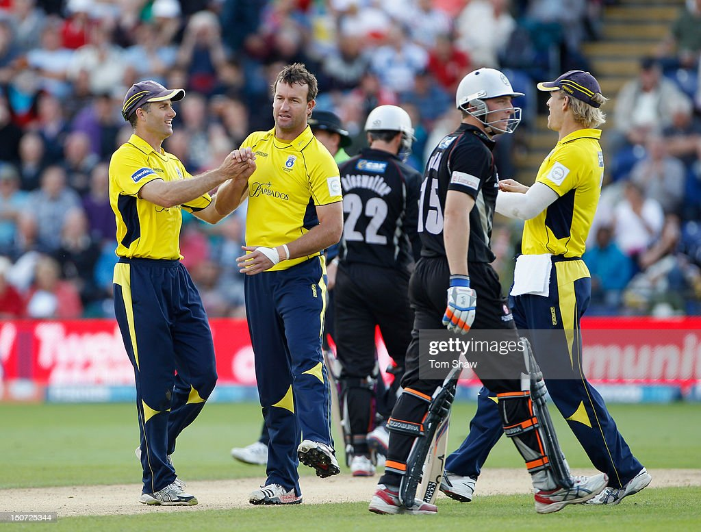 <a gi-track='captionPersonalityLinkClicked' href=/galleries/search?phrase=Sean+Ervine&family=editorial&specificpeople=579552 ng-click='$event.stopPropagation()'>Sean Ervine</a> of Hampshire celebrates taking the wicket of Jos Buttler of Somerset during the Friends Life T20 Semi Final match between Hampshire and Somerset at SWALEC Stadium on August 25, 2012 in Cardiff, Wales.