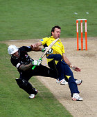 Sean Ervine of Hampshire collides with Peter Trego of Somerset during the Friends Life T20 Semi Final match between Hampshire and Somerset at the...