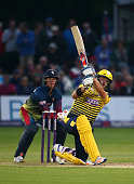 Sean Ervine of Hampshire hits out while Sam Billings of Kent looks on during the NatWest T20 Blast match between Kent and Hampshire at The Spitfire...