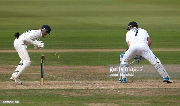 Sean Ervine of Hampshire is stumped out by Sam Billings of Kent during day three of the LV County Championship match between Hampshire and Kent at...