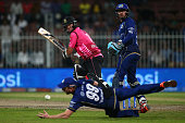 Sean Ervine of Libra hits a shot past the dive of Paul Collingwood of Capricorn during the Oxigen Masters Champions League match between Capricorn...