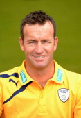 Sean Ervine poses for the camera wearing their T20 kit during the Hampshire CCC Photcall at the Ageas Bowl on April 3 2014 in Southampton England