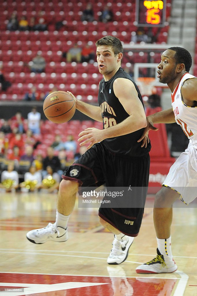Sean Esposito #20 of the IUPUI Jaguars dribbles the ball during a college basketball game against the Maryland Terrapins on January 1, 2013 at the Comcast Center in College Park, Maryland. The Terrapins won 81-63.