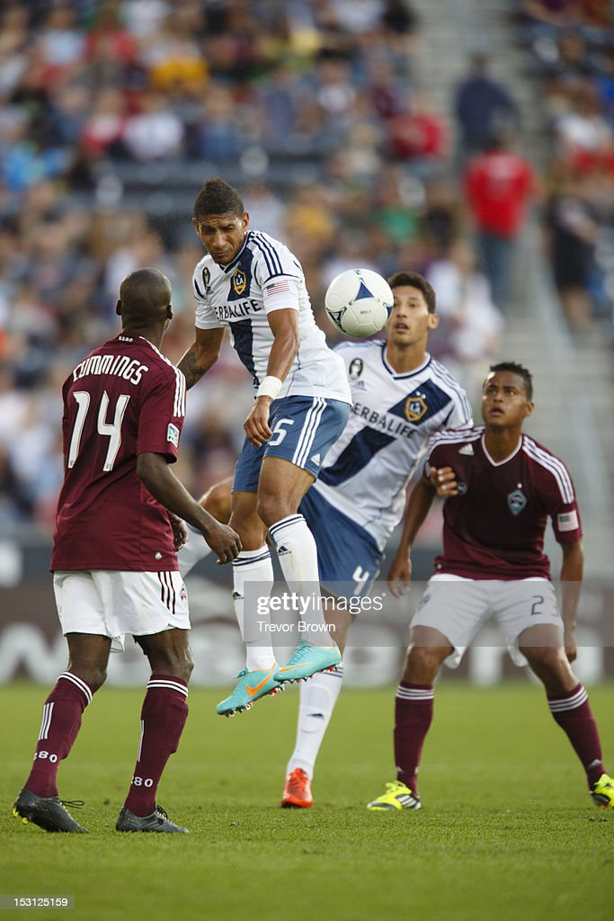 Sean Franklin of Los Angeles Galaxy heads the ball away from Omar Cummings of Colorado Rapids during their MLS match at Dick's Sporting Goods Park...