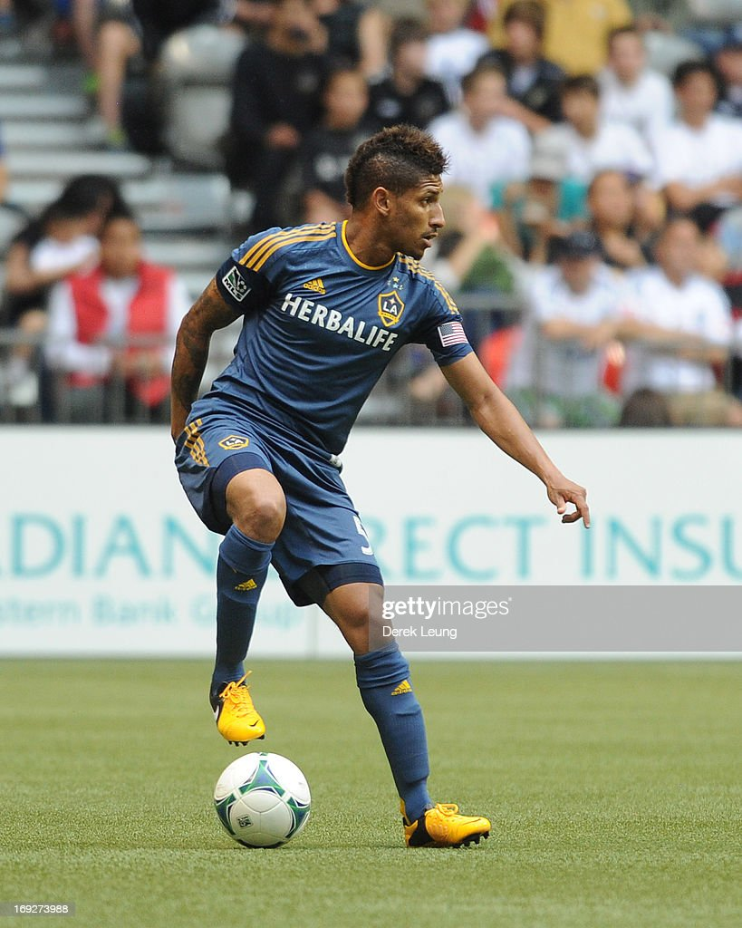Sean Franklin #5 of the Los Angeles Galaxy in action against the Vancouver Whitecaps during an MLS Game at B.C. Place on May 11, 2013 in Vancouver, British Columbia, Canada.