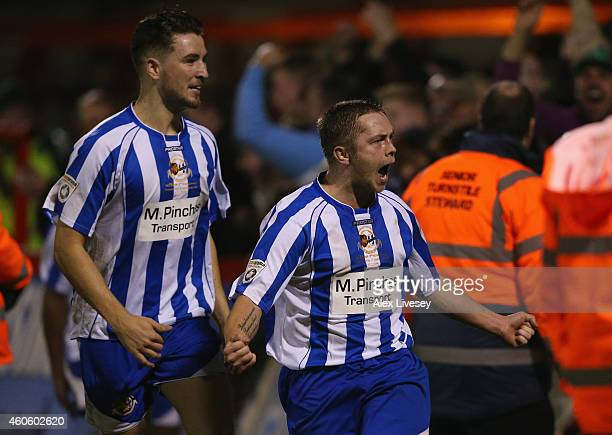 Sean Geddes of Worcester City celebrates after scoring during the FA Cup Second Round Replay match between Worcester City and Scunthorpe United at...