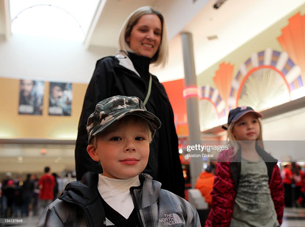 Sean Gilbert is all smiles after viewing 'The Muppets' movie with his mother Elizabeth Gilbert, rear, and his sister Kathryn Gilbert, rear right.