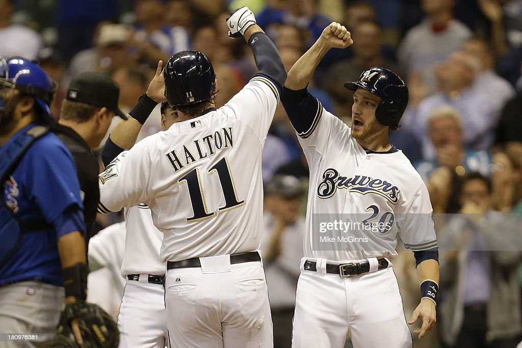 Sean Halton #11 of the Milwaukee Brewers celebrates with <a gi-track='captionPersonalityLinkClicked' href=/galleries/search?phrase=Jonathan+Lucroy&family=editorial&specificpeople=5732413 ng-click='$event.stopPropagation()'>Jonathan Lucroy</a> #20 after hitting a grand slam homw run in the bottom of the first inning against the Chicago Cubs at Miller Park on September 18, 2013 in Milwaukee, Wisconsin.