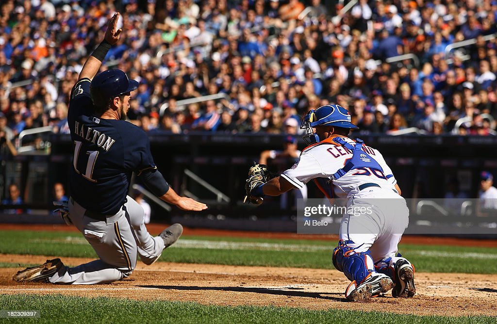 Sean Halton #11 of the Milwaukee Brewers is tagged out by Juan Centeno #36 of the New York Mets during their game at Citi Field on September 29, 2013 in New York City.