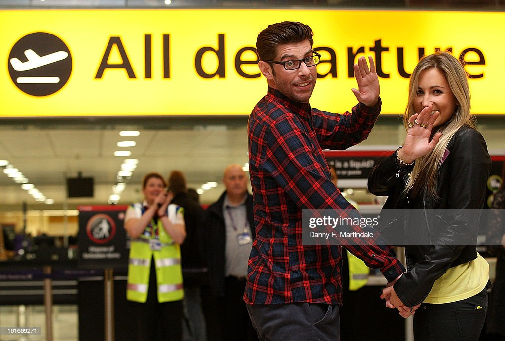 Sean Hinchion and Daisy Carpenter go through the departures gate after they picked each other to go on a blind date trip to LA at Heathrow Airport on February 14, 2013 in London, England. Claudia Winkleman hosted the UK's first ever live dating show on Valentine's Day with the prize being a trip in Air New Zealand's economy skycouch to LA.