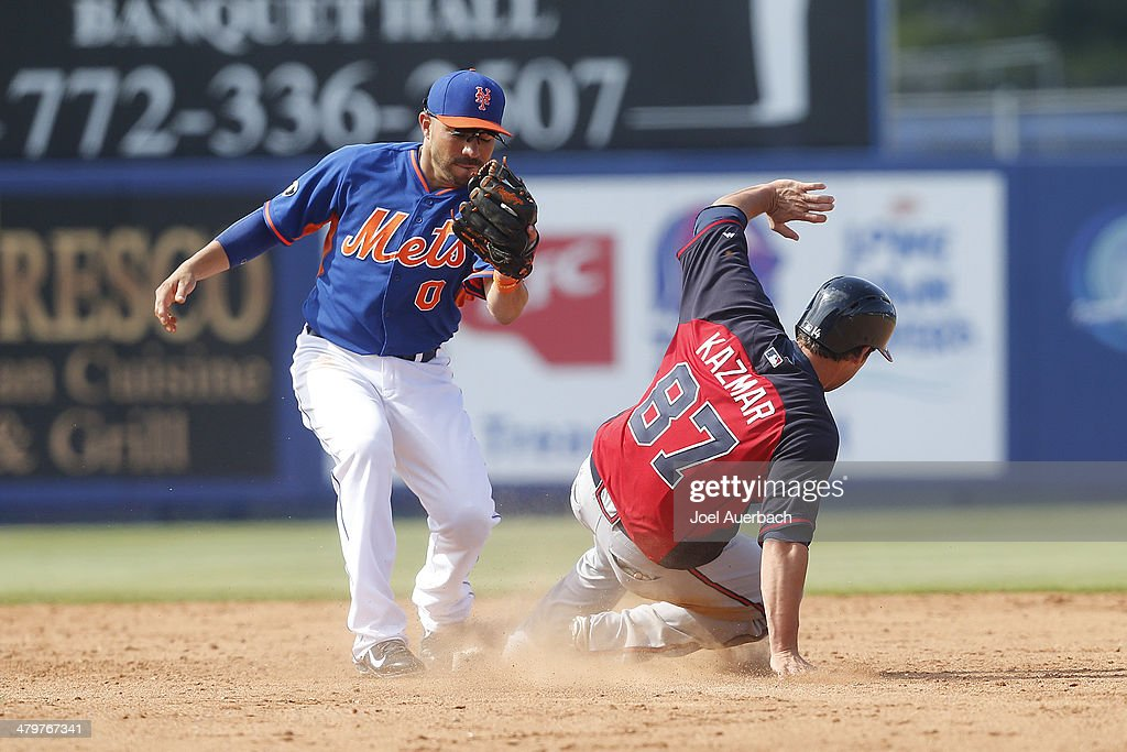 Sean Kazmar #87 of the Atlanta Braves steals second base ahead of the throw to <a gi-track='captionPersonalityLinkClicked' href=/galleries/search?phrase=Omar+Quintanilla&family=editorial&specificpeople=551479 ng-click='$event.stopPropagation()'>Omar Quintanilla</a> #0 of the New York Mets in the ninth inning during a spring training game at Tradition Field on March 20, 2014 in Port St. Lucie, Florida. The Mets defeated the Braves 7-6.