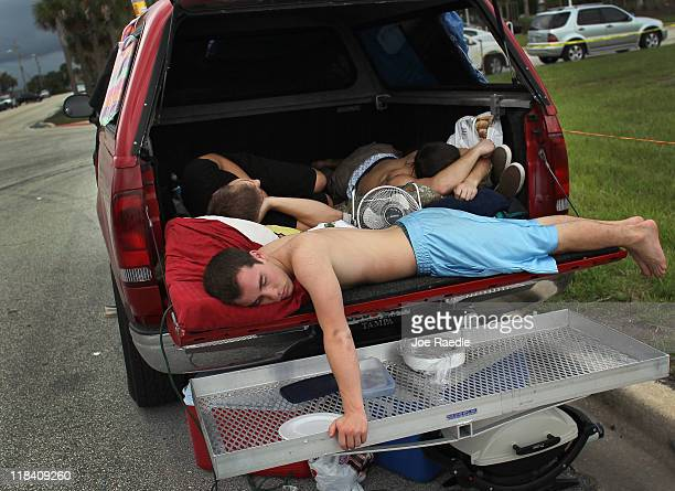 Sean Kelly Matt Oldenfield and Cameron Pullara from Tampa Florida sleep in the back of their truck as they wait to watch the launch of Space shuttle...