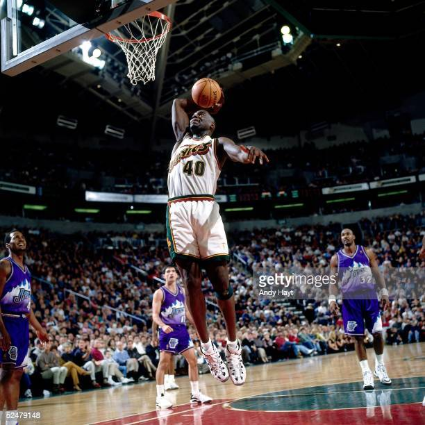 Sean Kemp of the Seattle Sonics goes up for a slam dunk against the Utah Jazz during an NBA game at Key Arena on December 1 1996 in Seattle...