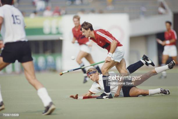 Sean Kerly of the Great Britain field hockey team pictured in action as he advances past a West Germany player during play to beat West Germany 31 to...