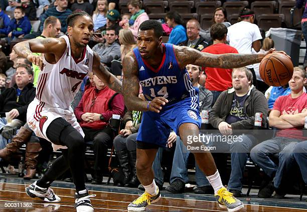 Sean Kilpatrick from the Delaware 87ers gets a step around Rodney McGruder from the Sioux Falls Skyforce at the Sanford Pentagon December 5 2015 in...