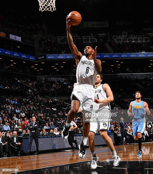 Sean Kilpatrick of the Brooklyn Nets goes up for the layup against the Denver Nuggets on January 22 2016 at Barclays Center in Brooklyn New York NOTE...
