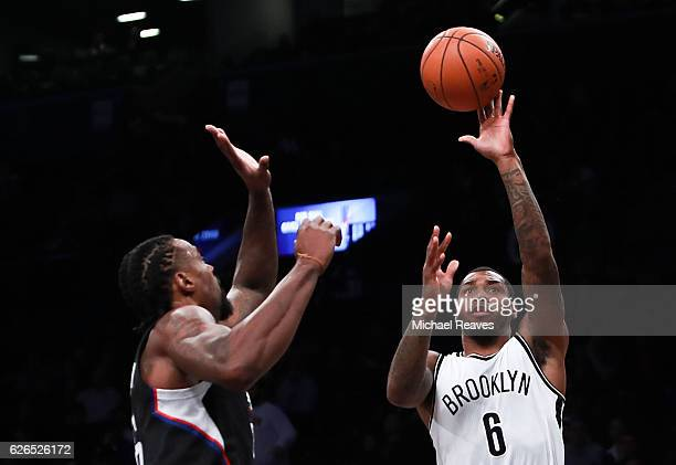 Sean Kilpatrick of the Brooklyn Nets puts up a shot over DeAndre Jordan of the Los Angeles Clippers in the first half at Barclays Center on November...